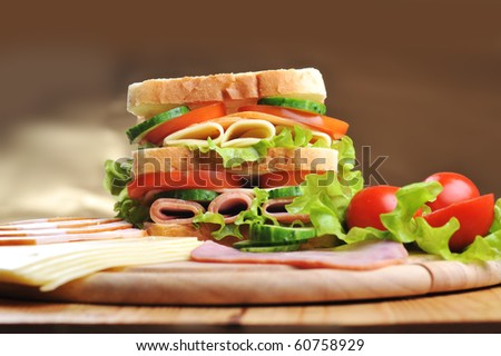Fresh and tasty sandwich on wooden  table - stock photo