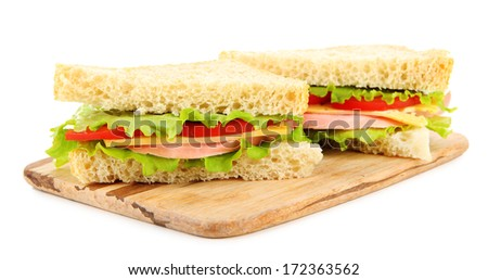Fresh and tasty sandwiches on cutting board isolated on white - stock photo