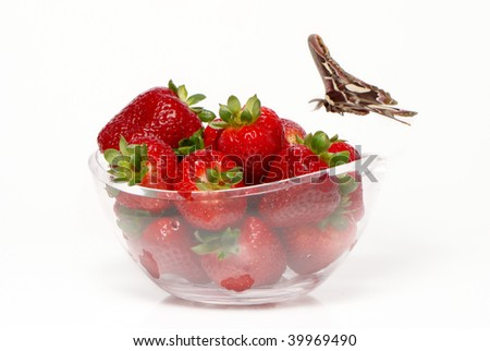 Fresh and tasty strawberries and butterfly