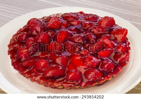 Fresh and tasty strawberry cake on the restaurant table - stock photo