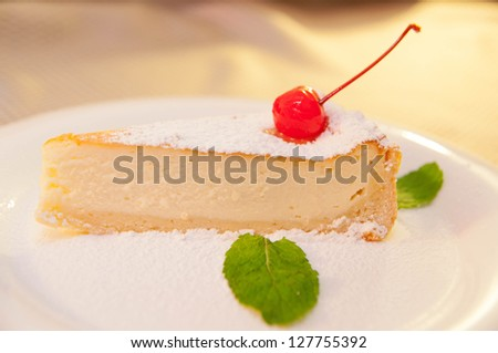 Fresh, appetizing cheese cake with cherry