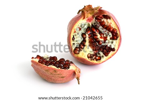 Fresh appetizing pomegranate on a white background