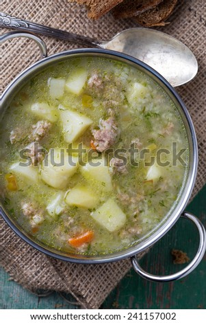 Fresh appetizing  soup with meat and vegetables  in  bowl on table. Selective focus. - stock photo