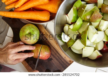 Fresh apple and carrot being prepared to be juiced - stock photo