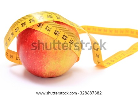 Fresh apple and tape measure on white background, concept for slimming, lifestyle and healthy nutrition