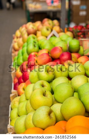 Fresh apple at marketplace ready for sale. Shallow depth of field. - stock photo