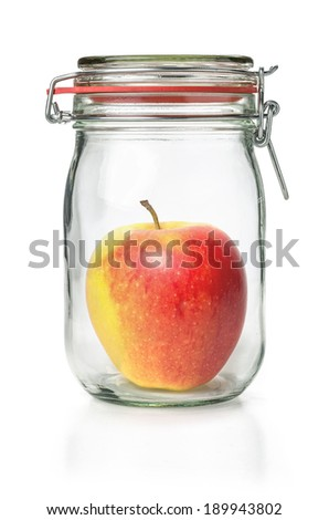 Fresh apple in a canning jar - stock photo