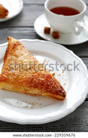 Fresh apple pie on a plate, side view