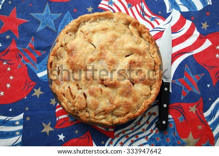 Fresh Apple Pie on an American Flag Pattern Background. Nothing says AMERICA better than Apple Pie.  - stock photo