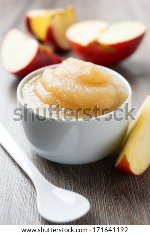 fresh apple puree with sliced apple - stock photo