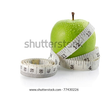 fresh apple with measuring tape. isolated over white background - stock photo