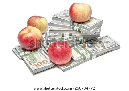 Fresh apples on a stack of money packs of new one hundred United States Dollar bills ($100 USD) isolated on white background. Inflation and crisis concept - stock photo