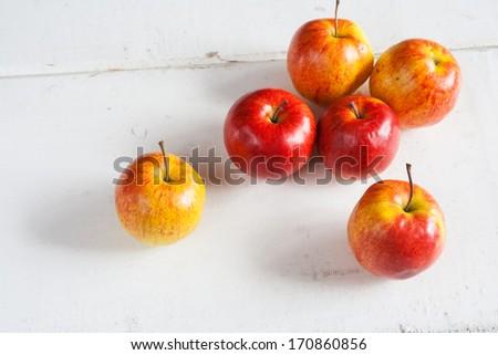 fresh apples on white table - stock photo