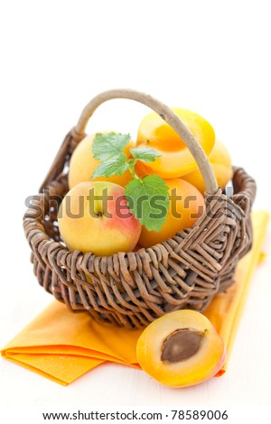 fresh apricots in a basket - stock photo