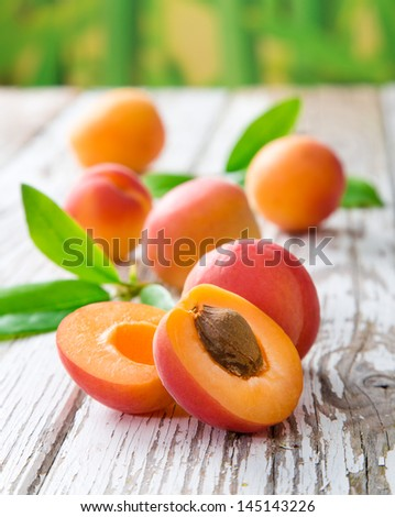 Fresh apricots on wooden table - stock photo