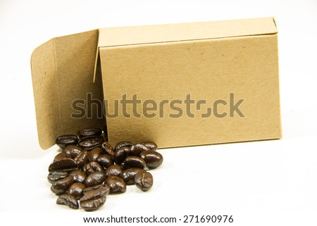 Fresh aromatic coffee beans in a paper coffee box - stock photo