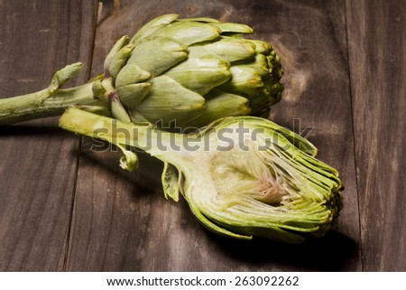 fresh artichokes on wooden background  - stock photo