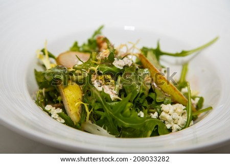 Fresh arugula and pear salad with gorgonzola cheese