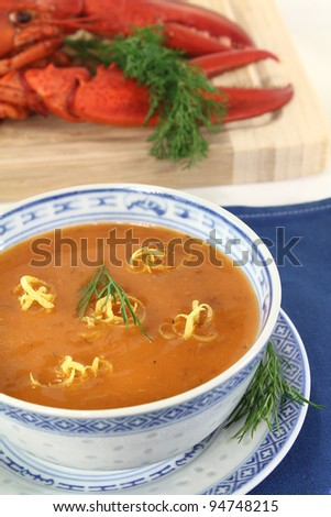 fresh Asian lobster soup with lemon, dill and bread - stock photo