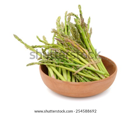 fresh asparagus in bowl on white background - stock photo