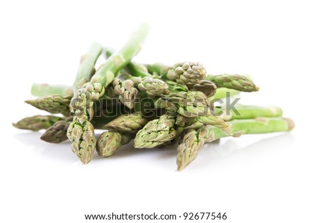 Fresh asparagus isolated over white - stock photo