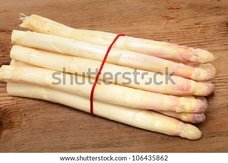 Fresh asparagus on a brown wooden table