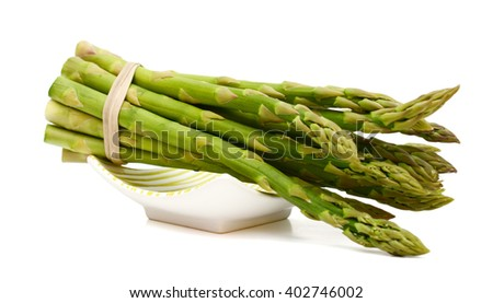 fresh asparagus on plate isolated on white  - stock photo