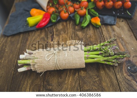 Fresh asparagus on wooden background - stock photo