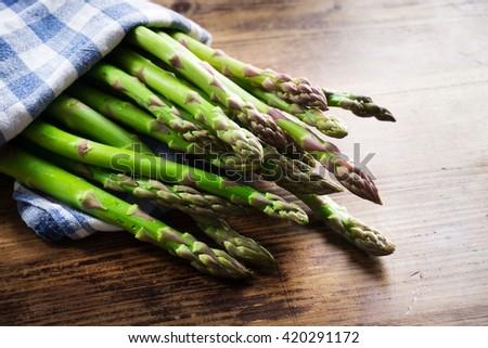 fresh asparagus on wooden table - stock photo