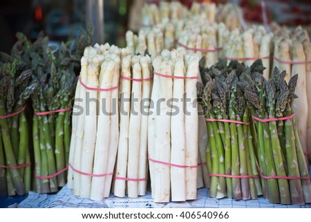 Fresh asparagus selling in a farmers market. Shot with a selective focus - stock photo
