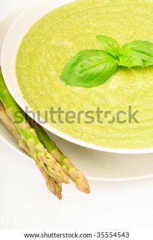Fresh asparagus soup with basil - stock photo