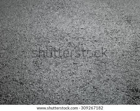 Fresh asphalt road closeup for background - stock photo
