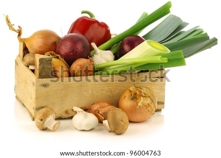 fresh assorted vegetables in a wooden crate on a white background - stock photo