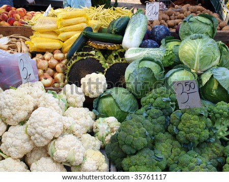 Fresh assorted vegetables in boxes on farmer's market - stock photo