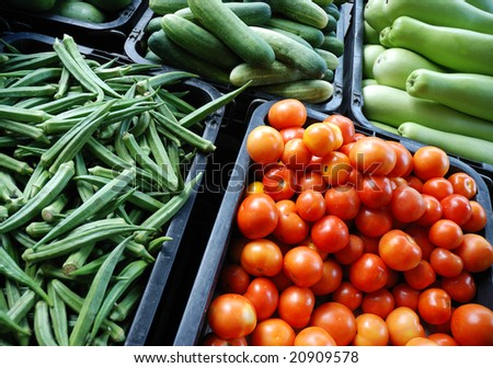 Fresh assorted vegetables in boxes on market - stock photo