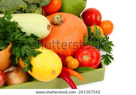 Fresh autumn vegetables in a green box on a white background. - stock photo