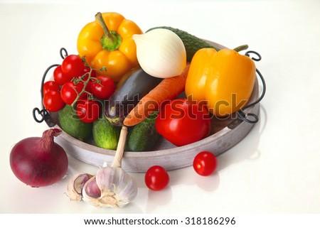 Fresh autumn vegetables on a white background - stock photo