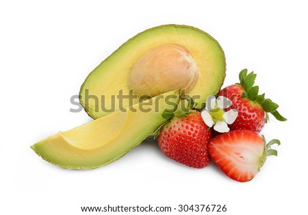 Fresh Avocado cut half and slice with strawberry and strawberry flower isolated on white background - stock photo