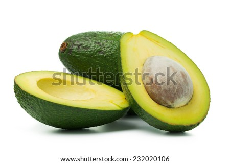 Fresh avocado in halved and whole on white background - stock photo