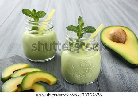 fresh avocado smoothie on gray background - stock photo