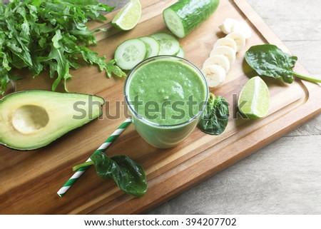 Fresh avocado smoothie on wooden board - stock photo
