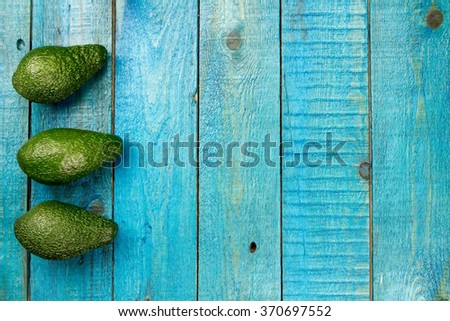 fresh avocados on wooden background. Healthy food, diet. Vegetarian. - stock photo