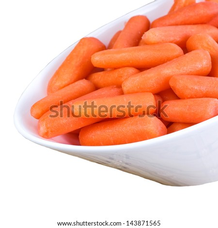 Fresh baby carrots in a bowl isolated on a white background with a square crop