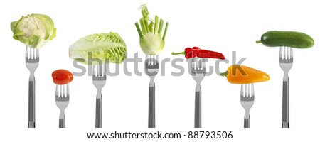 fresh baby vegetables on forks, isolated on white - stock photo