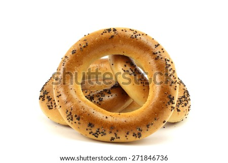 Fresh bagels with poppy seeds on a white background - stock photo