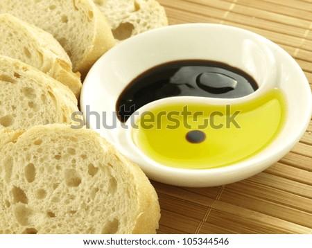 Fresh baguette, olive oil and balsamic vinegar - stock photo