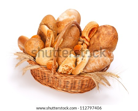 Fresh baked bread and pastry in basket on white background - stock photo