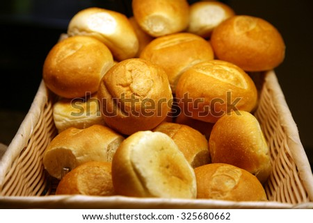 Fresh Baked Bread and Rolls. A generous variety of fresh baked rolls and breads piled high and ready to be eaten at a buffet on a cruise ship. Bread is enjoyed around the world by hungry people - stock photo