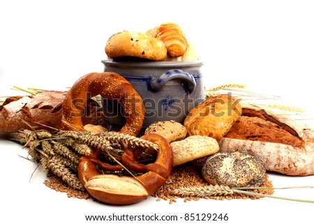 Fresh baked bread and wheat in a studio setting