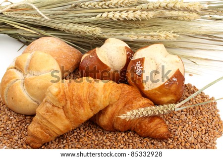 Fresh baked bread and wheat in a studio setting - stock photo